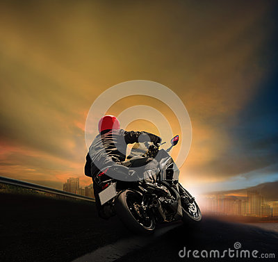 Free Man Riding Motorcycle On Asphalt Highway Against Sunset Sky Royalty Free Stock Image - 97085316