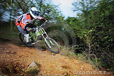 Man riding a mountain bike downhill style