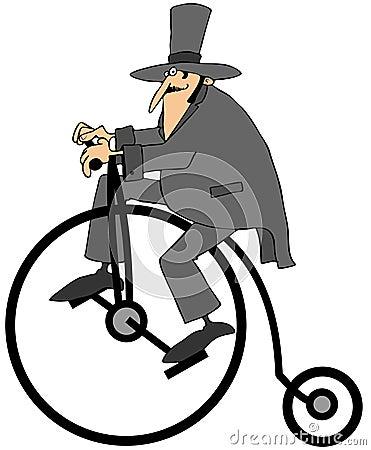 Man riding an old fashion bicycle