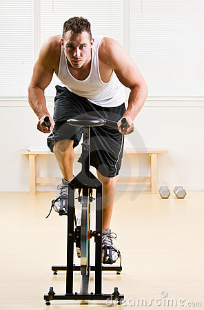 Free Man Riding Stationary Bicycle In Health Club Royalty Free Stock Photos - 17050278