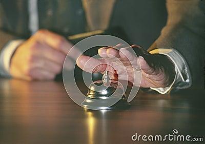 Man ringing service bell