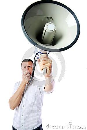 Man roaring loudly into megaphone Stock Photo