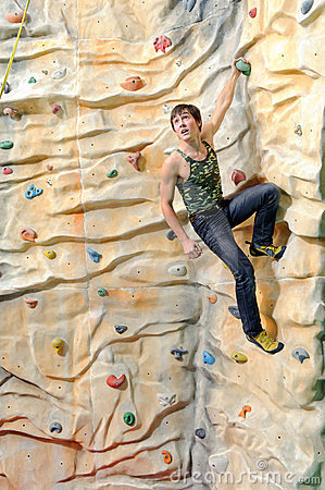 Man on rock wall