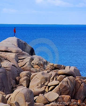 Man on rocky Cliff looking over the edge