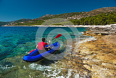 Man rowing in kayak at Adriatic sea