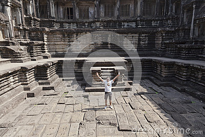 Man at ruins of Angkor Wat