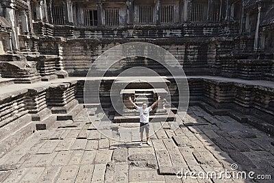 Man at ruins of Angkor Wat