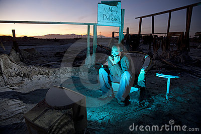Man in Ruins Watching Television