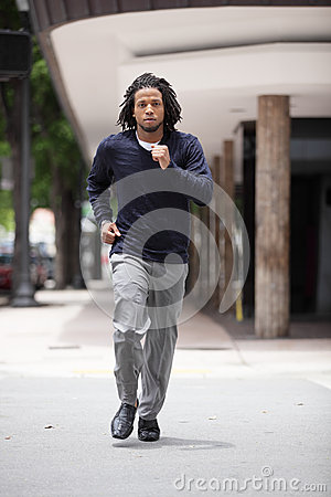 Free Man Running Across The Street Stock Image - 24987401