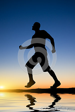 Man running against the evening sky
