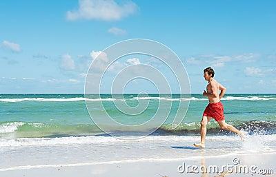 Man running along the coast