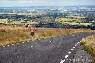 Man running along a country lane