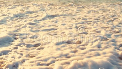 Man is running on the beach. Sea waves washing his legs. Man is running on the beach. Sea waves washing his legs stock video footage
