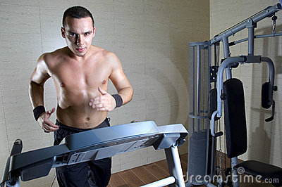 Man running at gym