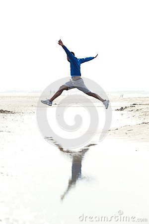 Man running and jumping at the beach