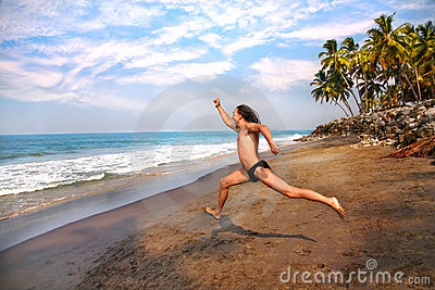 Man running to the ocean