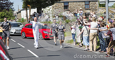 Man running with torch Editorial Photo