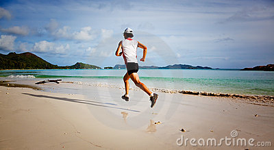 Man running on a tropical beach