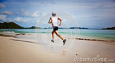 Man running on a tropical beach