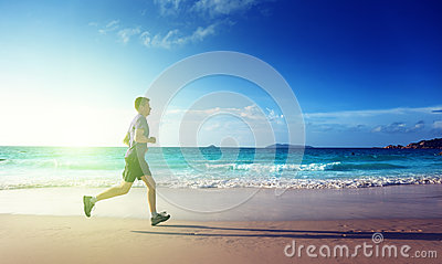 Man running on tropical beach