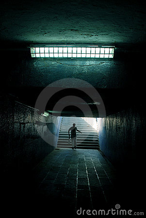a man running in the tunnel