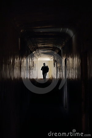Man runs along a dark corridor
