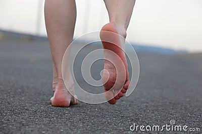 Man s bare feet walking away