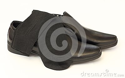 Man s black shoes and socks