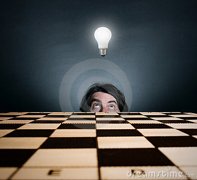 Man s face and burning light bulb.