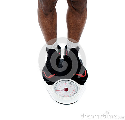 Man s feet on weighing scale