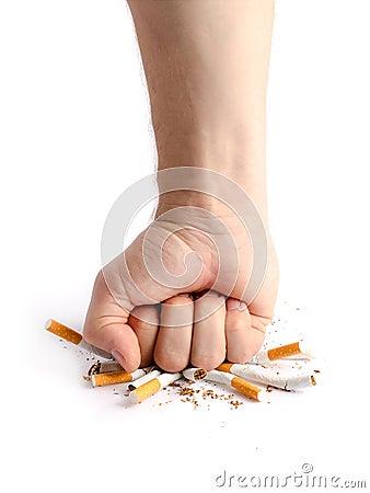 Man s fist crushing cigarettes