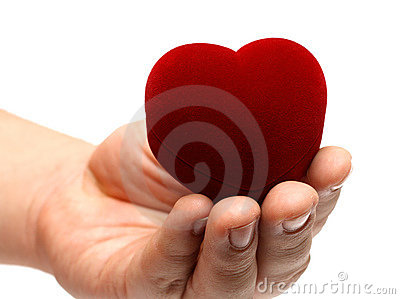 Man s hand gifting heart