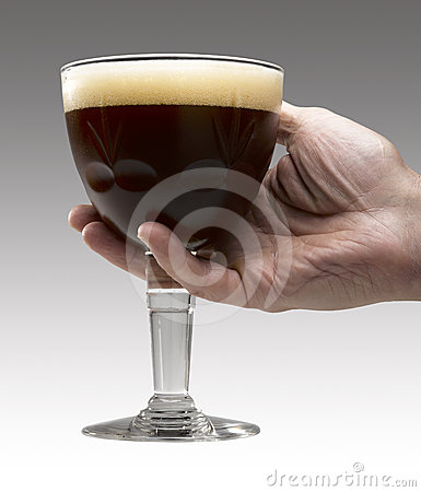 Free Man S Hand Holding A Trappist Beer Stock Image - 24471201