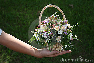 Man s hand holding bouquet