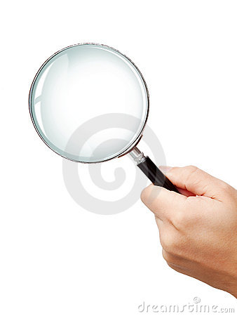 Man s hand holding classic magnifying glas