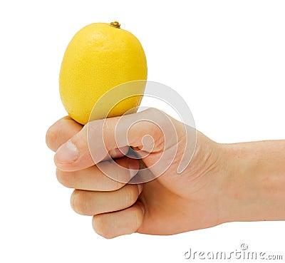 Man s hand holding a lemon