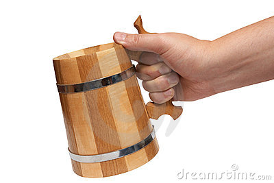 Man s hand holds big wooden beer mug