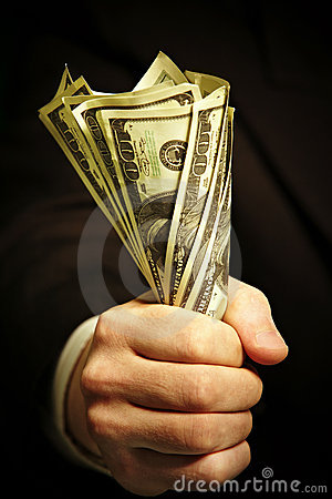 Man s hand holds dollars