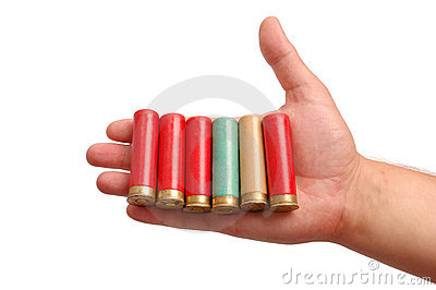 Man s hand with the hunting cartridges