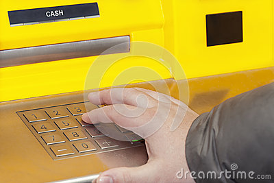 Man s hand near the cash machine
