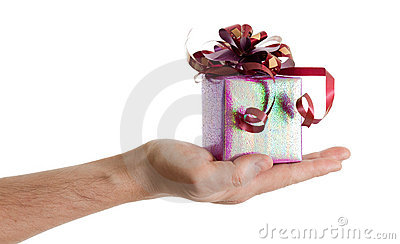 Man s hand with a small red gift box with ribbon