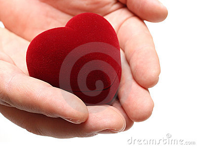 Man s hands gifting heart on valentine day