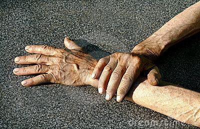 Man s hands at the gray background