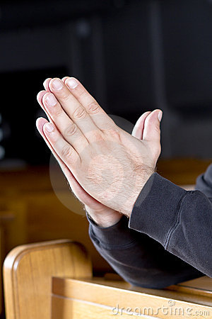 Man s hands in prayer position