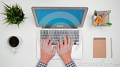 A Man`s Hands Typing on the Laptop Stock Photo