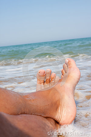Free Man S Legs On The Sand Beach Stock Images - 38232384