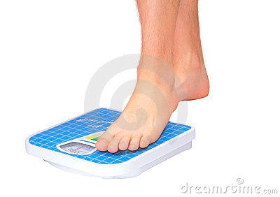 Man s legs ,weighed on floor scale.
