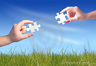 Man s and woman s hands with puzzles