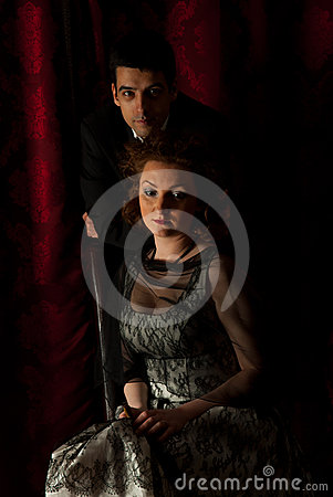 Man with sad woman in dark