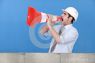 Man in safety hat screaming